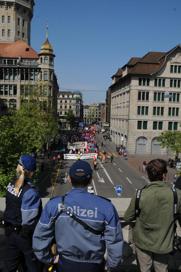Switzerland: Police observation of a demonstration in Zürich City. From Urania bridge down to the street where the protesters are passing by royalty free stock image