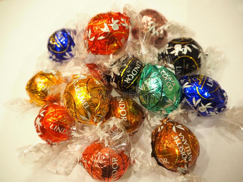 SWITZERLAND ZURICH, SEPTEMBER 2017: Chocolate candies Lindt Lindor. Candy in multi-colored wraps royalty free stock image