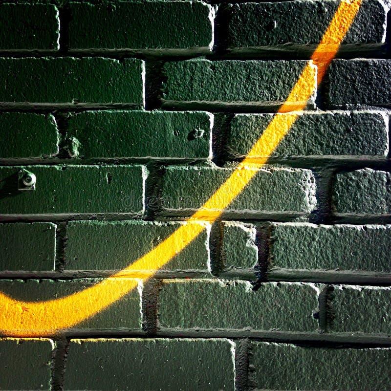 Swoosh em uma parede de tijolo imagens de stock