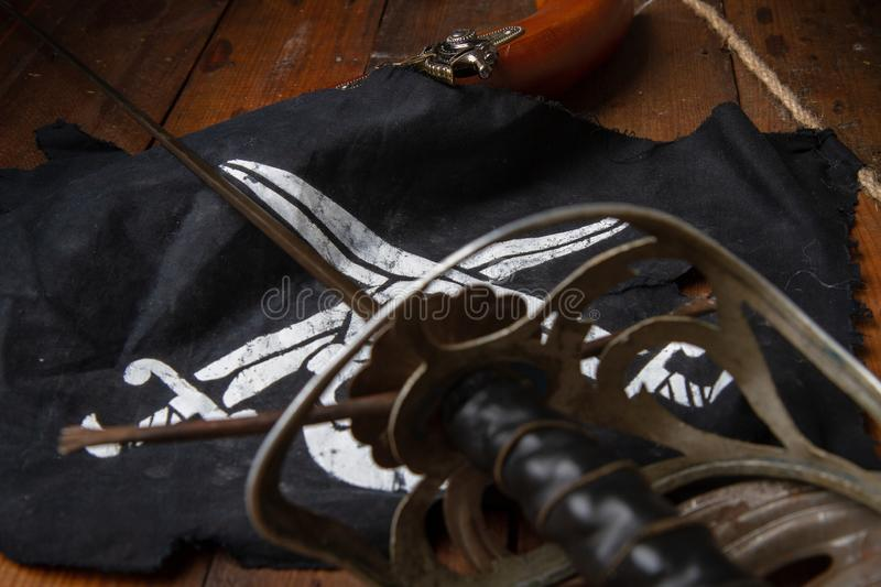 Sword flag pistol royalty free stock photography