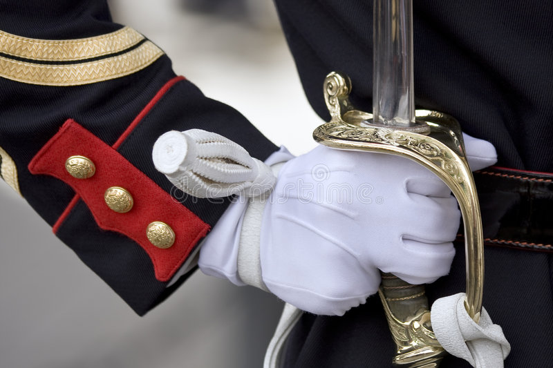 Sword of honour guard. Military honour guard holding his sword presenting arms royalty free stock photo