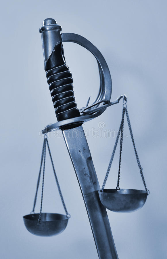 Sword scales of justice stock photo