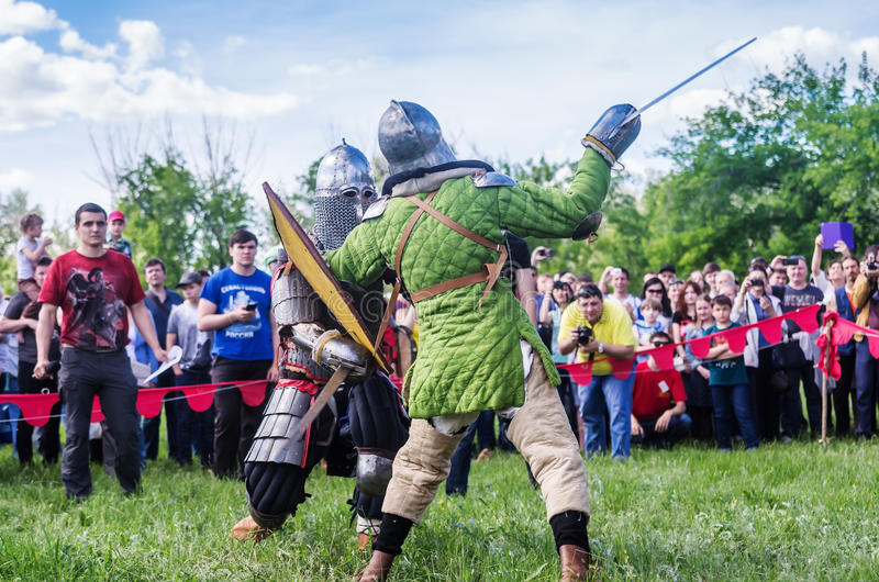 The swordfight heavily armed medieval warriors royalty free stock photos