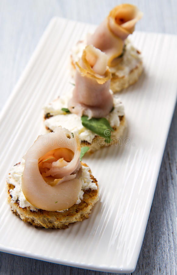 Swordfish canape stock photo