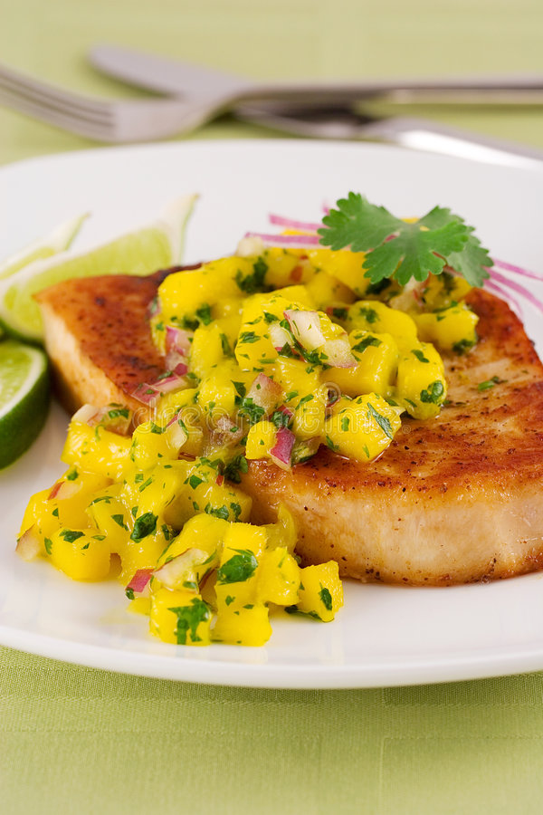 Swordfish with mango relish royalty free stock photography