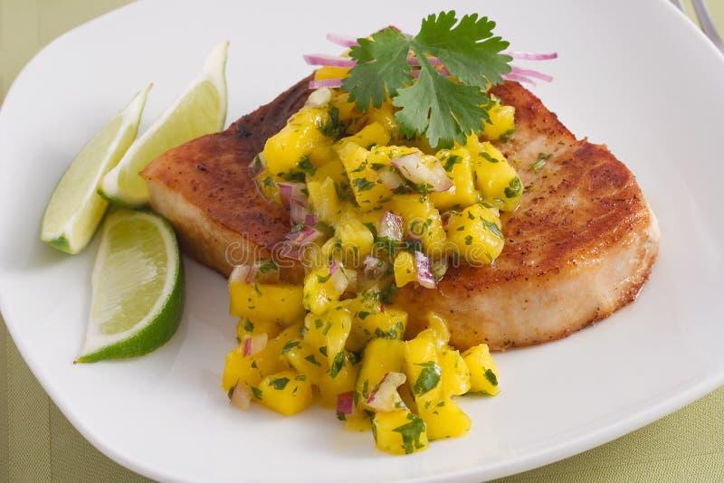 Swordfish with mango salsa stock image