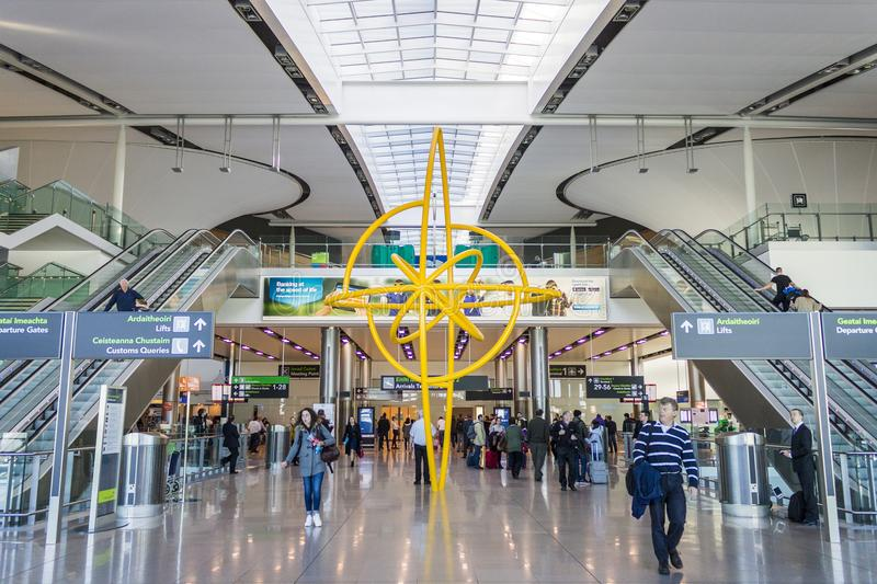 Dublin Airport, Ireland. Swords, Ireland. Interior view of the main hall of Dublin Airport Aerfort Bhaile Atha Cliath, crowded with people stock photo
