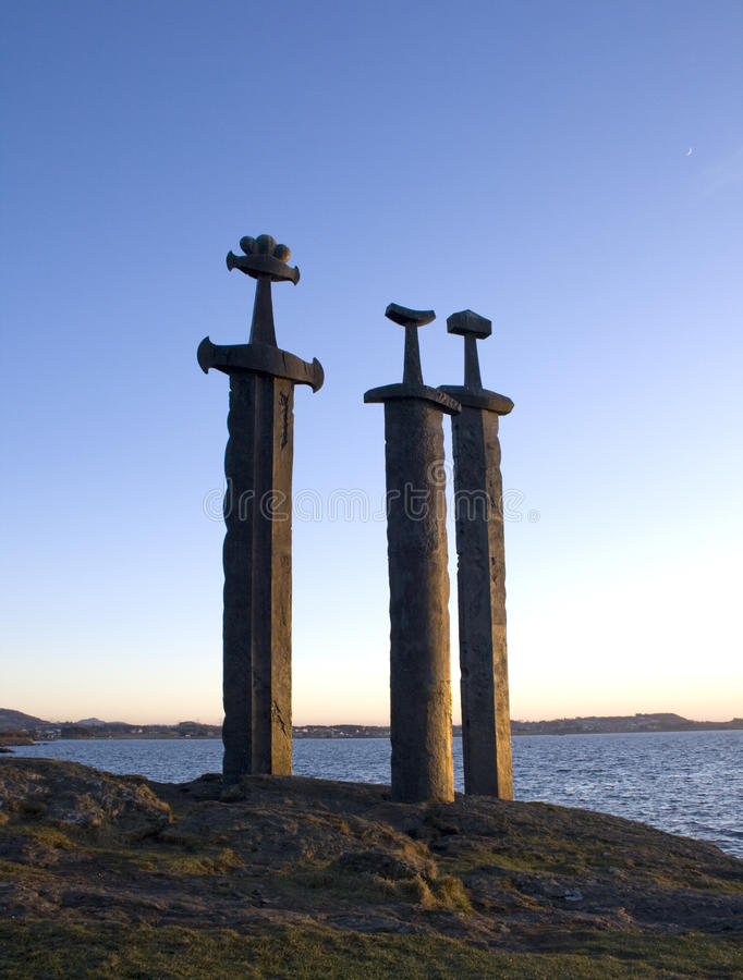 Swords in Rock. Three enormous bronze swords stand monument to the battle of Hafrsfjord in the year 872, when Harald HÃ¥rfagre (Fairheaded Harald) united stock images