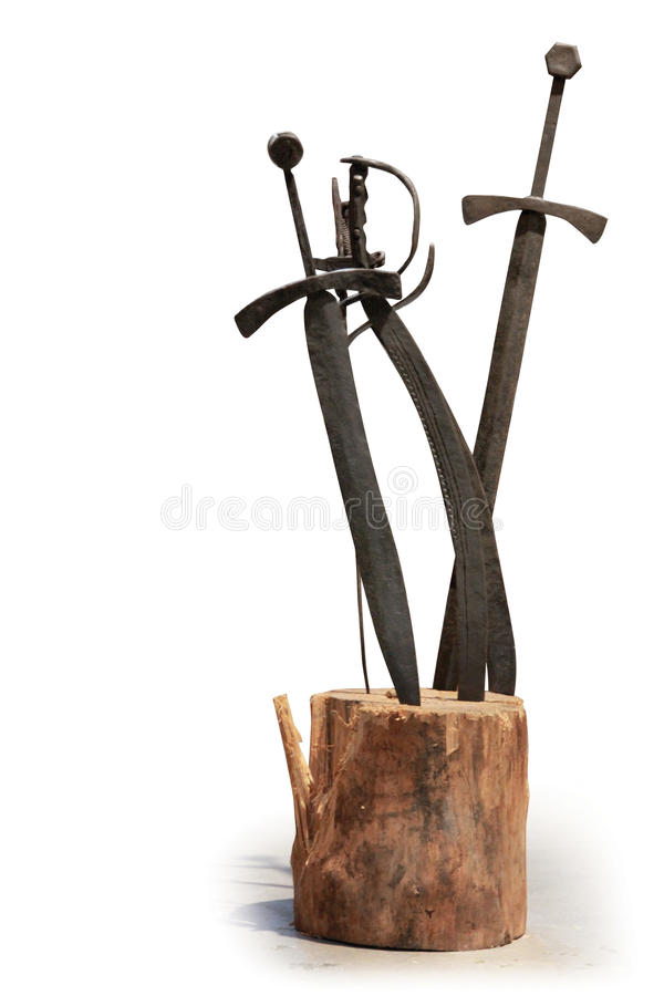 Swords. In wood, isolated, closeup stock photo