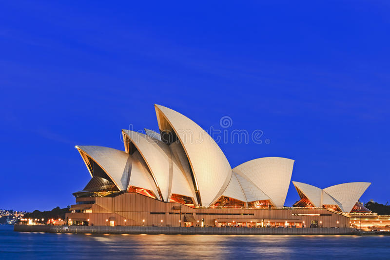 Sy Opera Close BLue Set. Sydney, Australia - 15 November 2016: Iconic worlds` buildings - Sydney Opera house in full glory at sunset, brightly illuminated royalty free stock photography