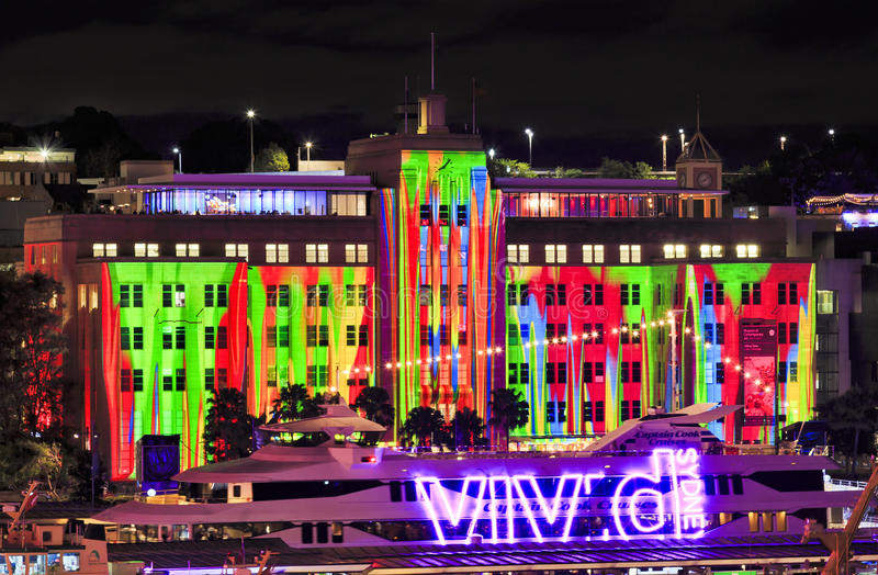 Sy Vivid 2016 MCA Ship. Sydney, Australia - 2016, June 7: Facade of Sydney Museum of Contemporary arts under projection of Vivid Sydney light show behind harbour stock photos