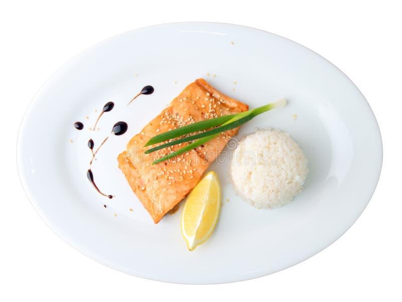 Syake teriyaki. On a white oval dish isolated on white background royalty free stock photography