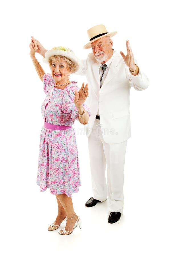 Sydliga pensionärer dansar tillsammans arkivbilder