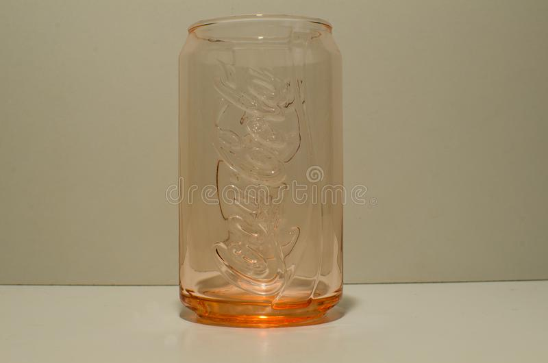 Coca Cola Coke can glass collection limited edition by McDonald Australia in Orange-red color. stock image