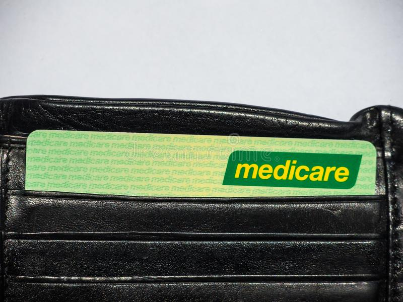Medicare card is a publicly funded universal health care system in Australia, the image shows the card in a black wallet. SYDNEY, AUSTRALIA – On February stock image