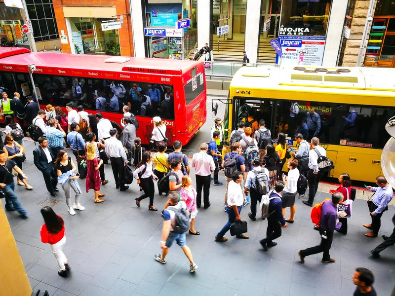 Crowd of people in rush hour at bus stop in Sydney CBD. royalty free stock images