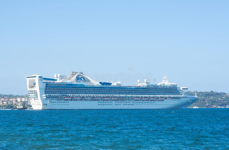 Golden Princess is a Grand class cruise ship, departing from Sydney harbour. stock photography