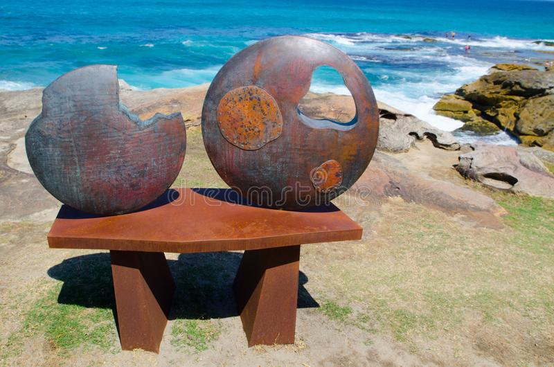 ` I put a Moon on the table, but it has hole and is lacking ` is a sculptural artwork by Yoshio Nitta at the Sculpture by the Sea. SYDNEY, AUSTRALIA. – royalty free stock photography