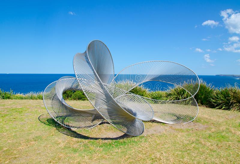 ` Indivisible ` is a sculptural artwork by Matthew Harding at the Sculpture by the Sea annual events free to the public. SYDNEY, AUSTRALIA. – On October royalty free stock image