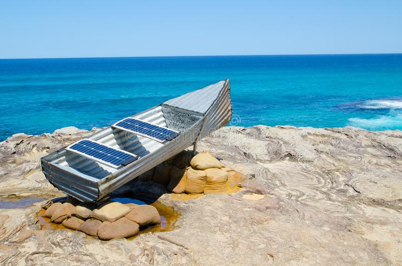 ` Les st Hill and tin Canoe ` is a sculptural artwork by John Blay, Amanda Stuart & Jane Ulman at the Sculpture by the Sea. SYDNEY, AUSTRALIA. – On royalty free stock photography