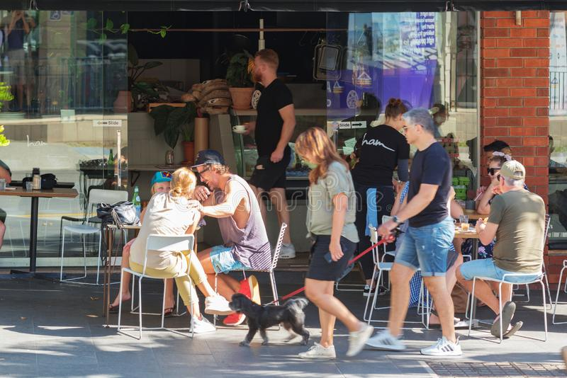 People having fun at outdoor cafe in Sydney royalty free stock image