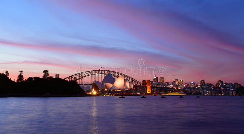 SYDNEY, AUSTRALIA - APRIL 8, 2014; Sunset over Sydney Harbour wi royalty free stock image