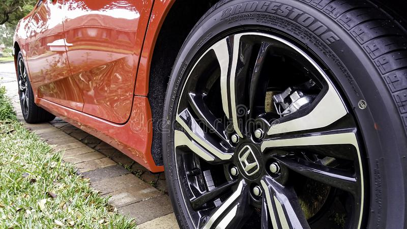 Close-up low angle view of the back wheel of a Honda Civic. Sydney, Australia - Aug 6, 2016: Close-up low angle view of the back wheel of a 10th Generation Honda royalty free stock image