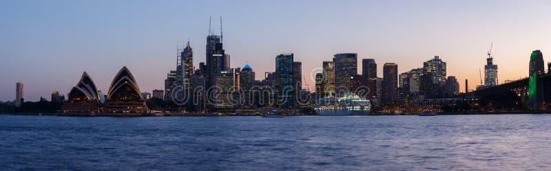 Sydney, Australia - Circa 2019 : Downtown Sydney and Sydney Opera House panorama at dusk, viewed from Kirribilli royalty free stock image