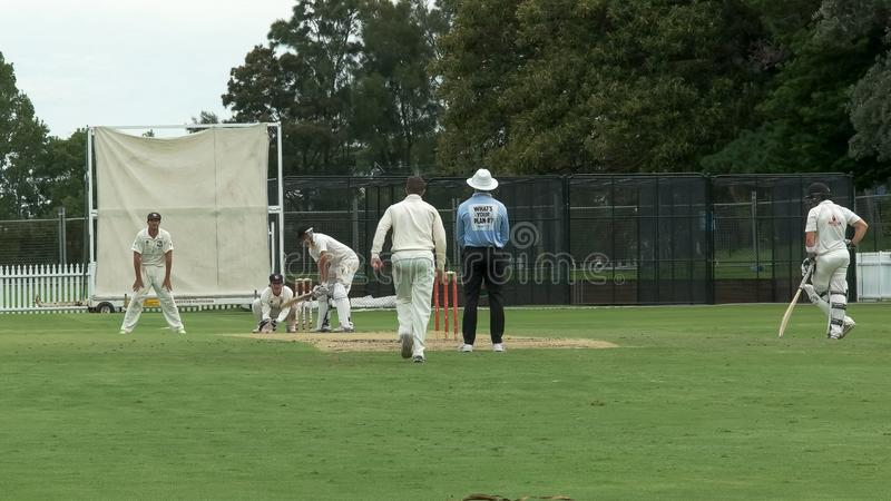 SYDNEY, AUSTRALIA - JANUARY 31, 2016: low angle view of a batsman facing a spin bowler in a sydney cricket game. SYDNEY, AUSTRALIA - JANUARY 31, 2016: low angle royalty free stock photo