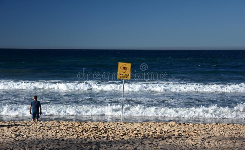 A sign reads Dangerous current royalty free stock photos