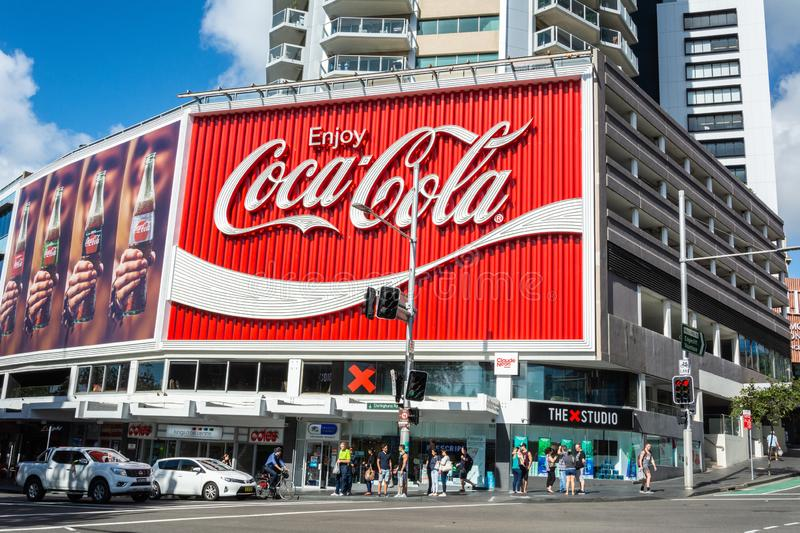 The Coca-Cola Billboard in Kings Cross, Sydney. Sydney, Australia - March 10, 2017. The Coca-Cola Billboard in Kings Cross, Sydney, with commercial properties stock photography