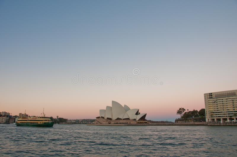 SYDNEY, AUSTRALIA - MAY 5, 2018: Sydney Opera House with famous. Sydney city ferry in late afternoon and twililght sky royalty free stock photography