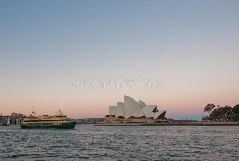 SYDNEY, AUSTRALIA - MAY 5, 2018: Sydney Opera House with famous. Sydney city ferry in late afternoon and twililght sky stock image