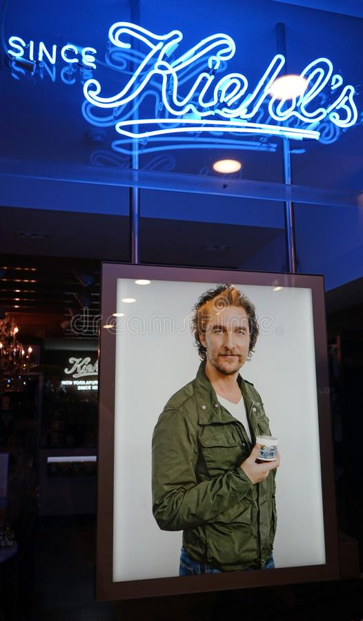 Close-up shot of Matthew McConaughey autism campaign poster in Kiehl`s window display. Sydney, Australia - November 03, 2017: Close-up shot of Matthew stock photography