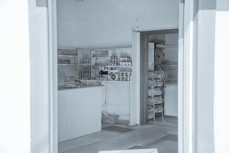 Old-fashioned corner store with groceries on shelves. royalty free stock images
