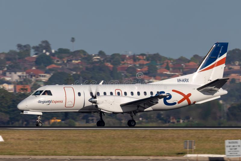 REX Regional Express Airlines Saab 340 twin engined regional commuter aircraft taking off from Sydney Airport. Sydney, Australia - October 7, 2013: REX Regional stock photos
