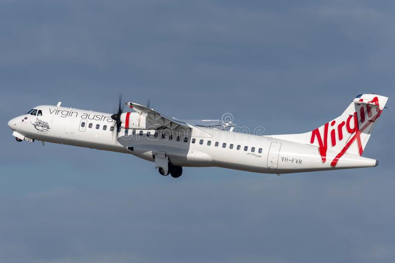 Virgin Australia Airlines ATR ATR-72 twin engine turboprop regional airliner aircraft taking off from Sydney Airport. Sydney, Australia - October 7, 2013: Virgin royalty free stock images
