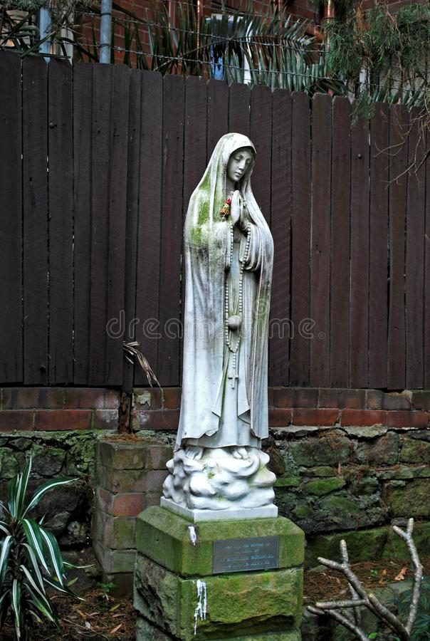 Nun statue in Peace Park of St. Canice`s Parish, praying for the repose of the soul royalty free stock images