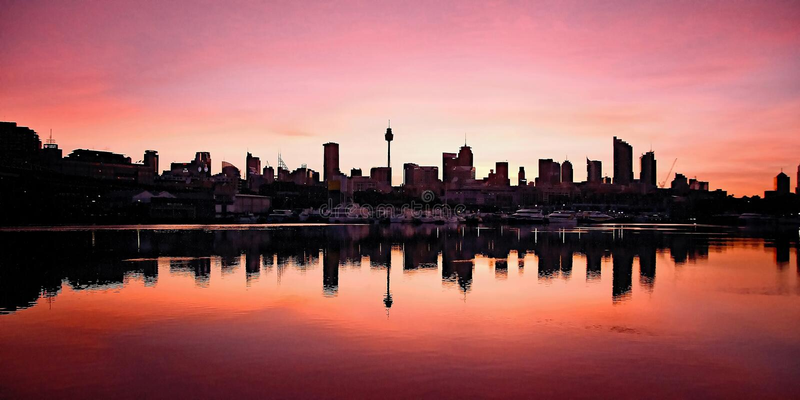 Sydney CBD soluppgång, Blackwattle fjärd australasian royaltyfri fotografi
