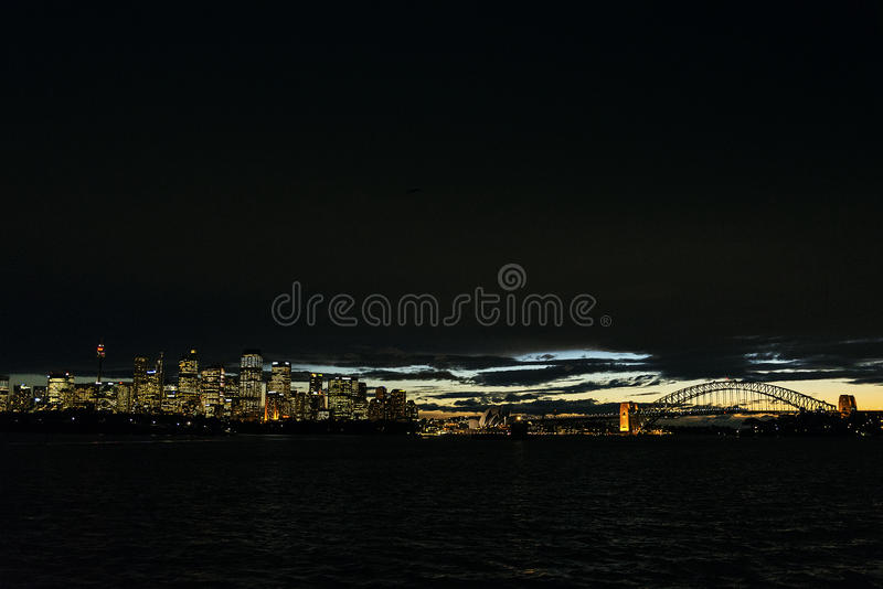 Sydney city harbour sunset skyline in australia royalty free stock photography
