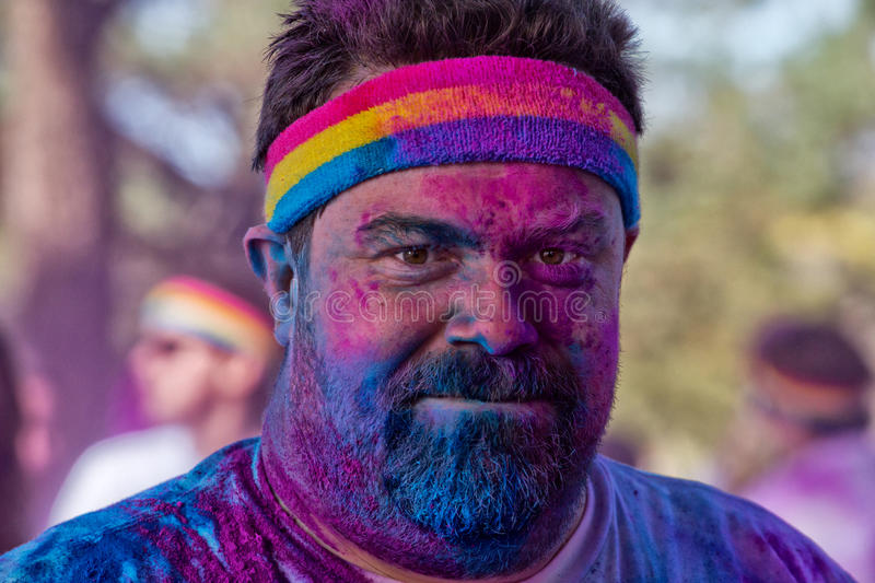 Sydney Color Run. SYDNEY,AUSTRALIA - AUGUST 24,2014: A competitor in the 'Color Run' fun run in Centennial Park. Runners are doused in coloured powder, bubbles stock image