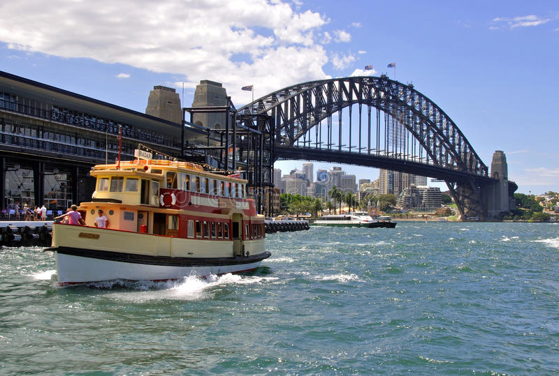 Sydney ferry RADAR and the Harbour Bridge. The ferry RADAR arriving at Circular Quay, Sydney stock images