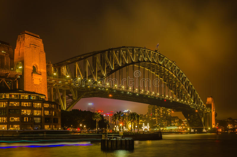 Sydney Harbour bridge on a foggy night. With light trails of moving ferries. It is a major tourist attraction in Sydney,New South Wales royalty free stock photo