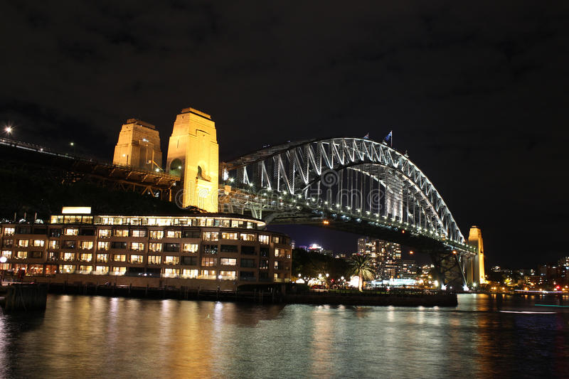Sydney Harbour Bridge at night Australia. Sydney Harbour Bridge at night with city lights reflected in water stock photos