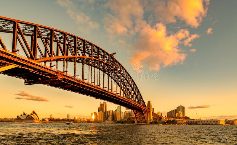 Sydney Harbour Bridge and Opera House at golden sunset stock image