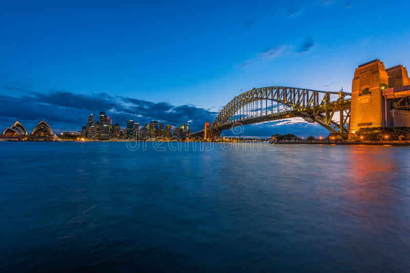 Sydney Harbour at night viewed from Milsons Point in North Sydney Australia. FEB 15,2017 Sydney Harbour is a beautiful meandering waterway, famous around the royalty free stock photo