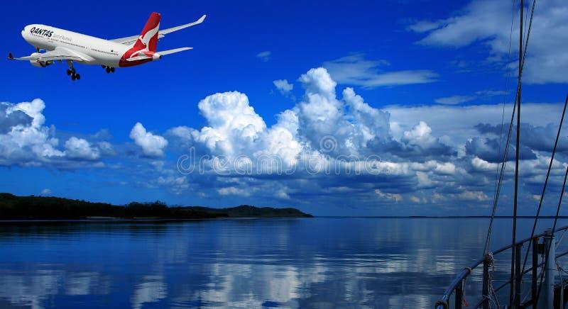 Aircraft in flight with cumulonimbus cloud in blue sky. Australia. royalty free stock image