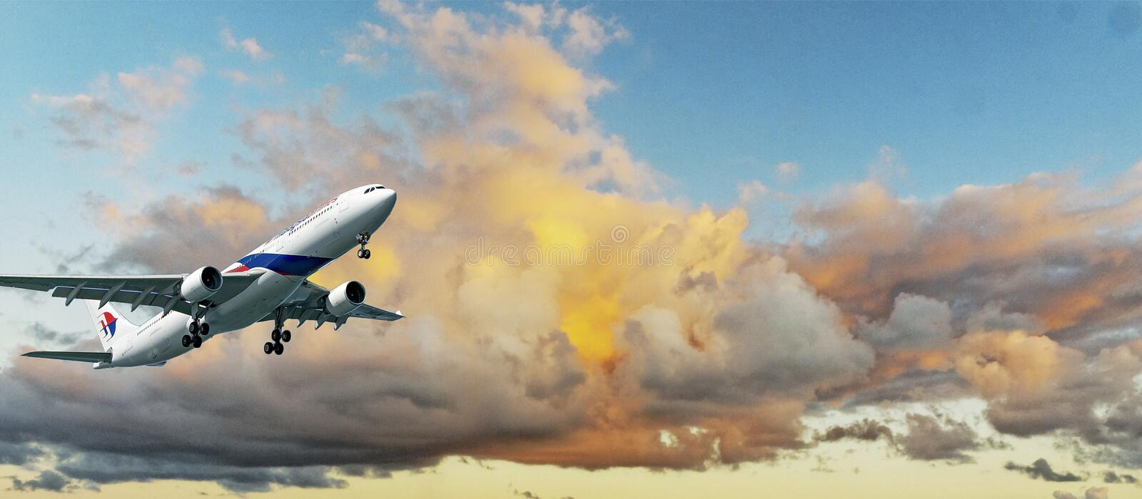 Aircraft in flight with Colourful cumulonimbus cloud in blue sky stock photography