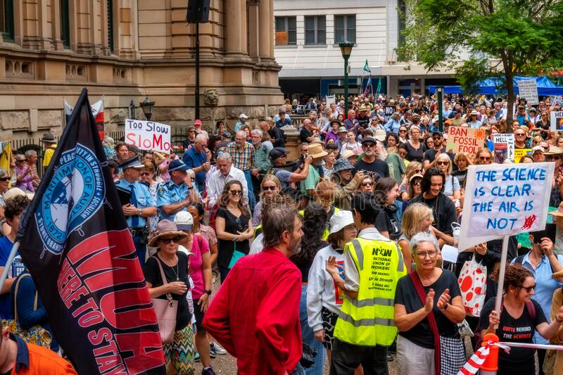 People at a climate change protest at Sydney Town Hall. royalty free stock images