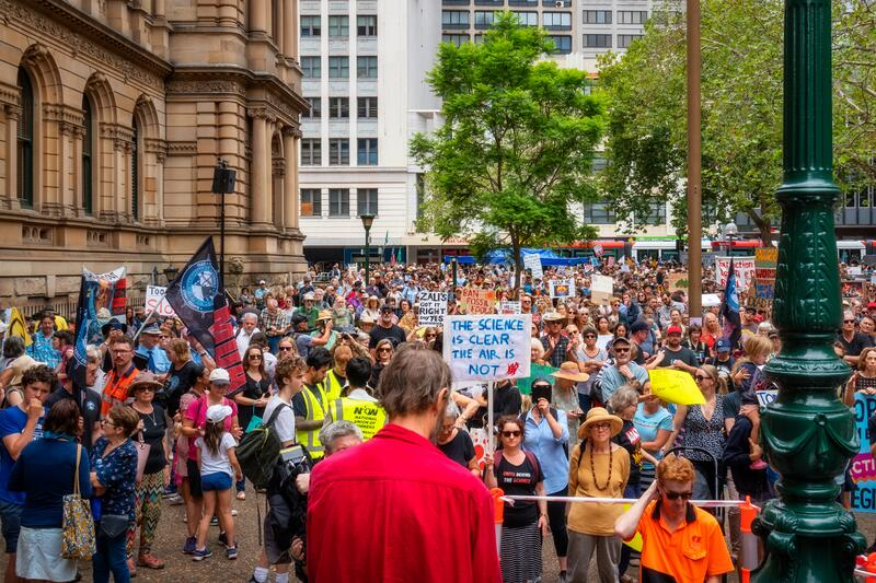People with placards and flags at a climate change protest at Sydney Town Hall. royalty free stock photography